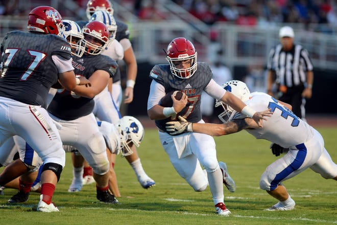 Vero Beach High School quarterback Nick Celidonio moves the ball up the field through the Wellington defense Friday, Aug. 31, 2018 during a game at the Citrus Bowl. Vero Beach won its 46th straight regular-season game, moving it into a tie for the second-longest win streak in Florida history.