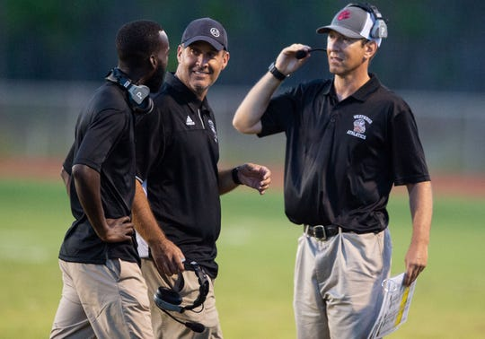 Fort Pierce Westwood head football coach Chris Hutchings (center), shown here in the Panthers game at Port St. Lucie on Aug. 31, 2018, told his team he was stepping down on Friday.
