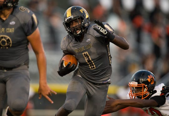 Treasure Coast's Joey Fleurjuste runs the ball in the fist half of their game against Cocoa at South County Stadium on Friday, August 31, 2018 in Port St. Luce. Fleurjuste is one of 40 players going on the Treasure Coast Elite Bus Tour to visit college campuses.