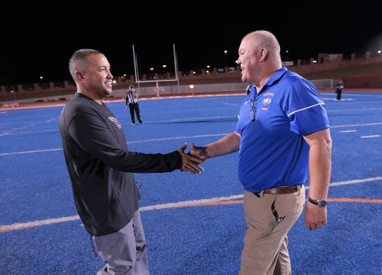Eastlake Head Coach Jay Calderon shakes hands with Canutillo Head Coach Scott Brooks after Eastlake's 17-14 win earlier this season. Brook is the father of Bo Brooks, who is having a strong season for Division II, Missouri S&T.