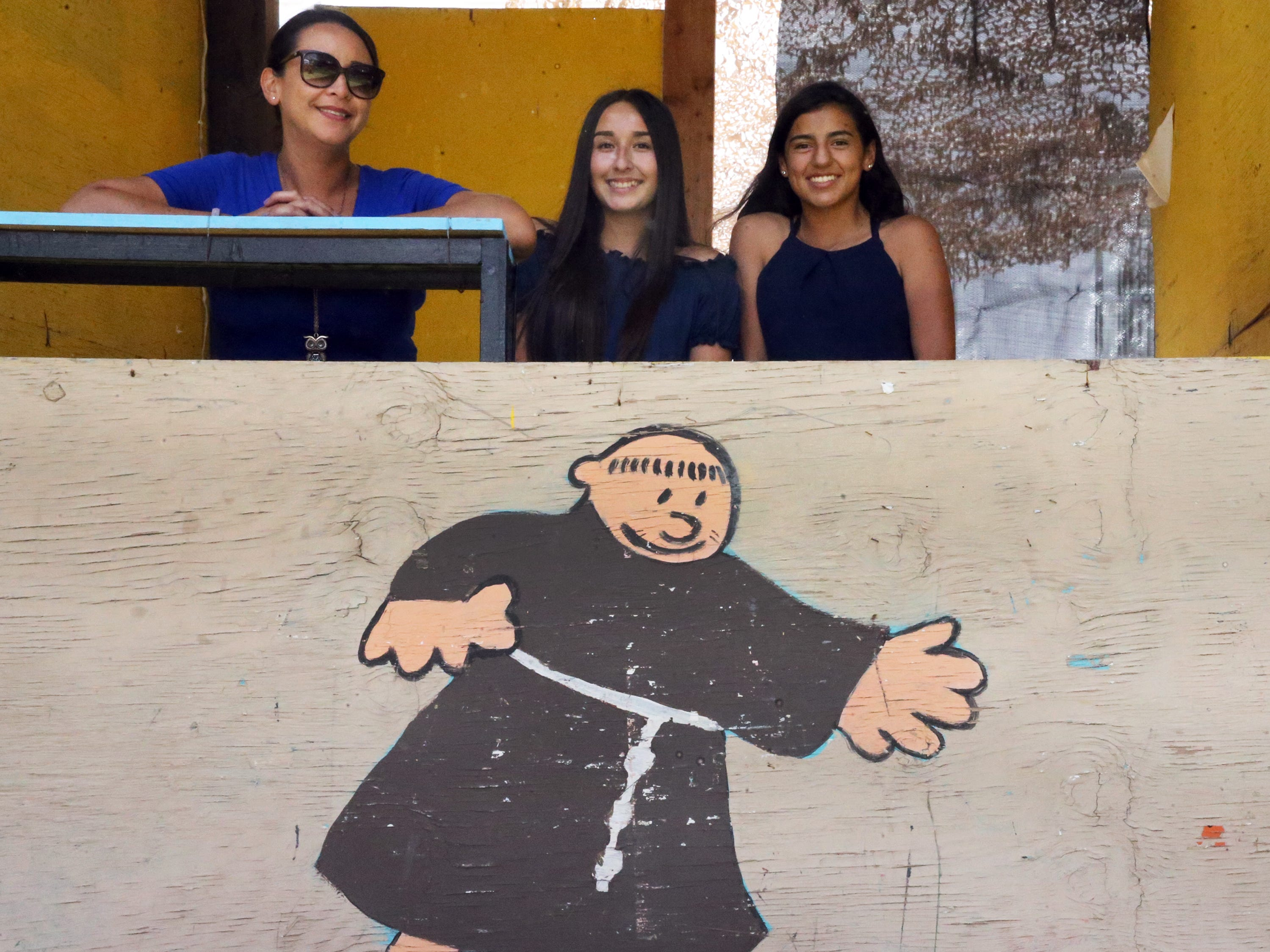 Lizette Anguiano, left, with daughter Julie Anguiano, center, and niece Alexis Anguiano at a soda booth Saturday.