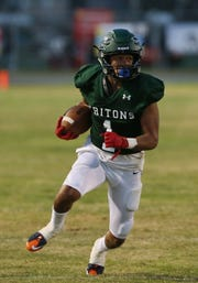 Pacifica High's Savonne Perris Farmer heads to the end zone to score a touchdown during the Tritons' 42-20 win over Newbury Park on Friday night.