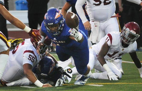 Westlake and Oxnard players scramble for a fumble during Friday night's game at Westlake High. The Warriors won 24-20.