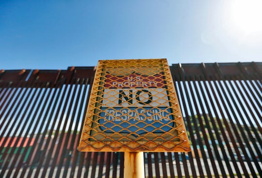 In this April 9 photo, the international border between Mexico and the United States is seen from Nogales, Ariz.
