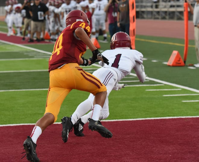 Victor Duran catches a touchdown pass last season for Santa Paula. Duran led the county in receiving yards and also 12 TD receptions.catches in a game (14) and single-season TD catches (12).