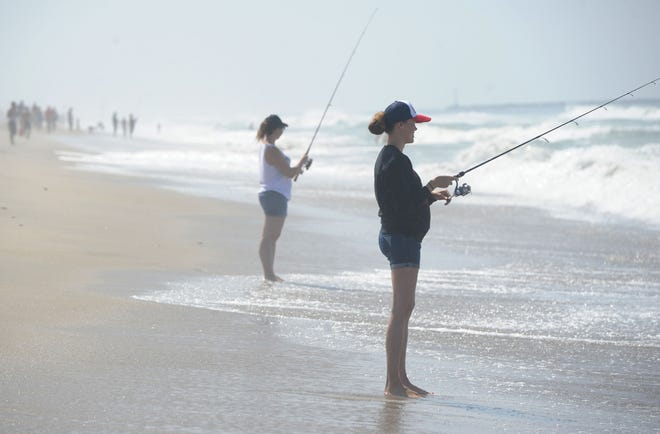 Jen Jurick, left, and Sam Dee participate in Saturday's perch tournament at Oxnard Beach Park to benefit FOOD Share and Project Understanding.