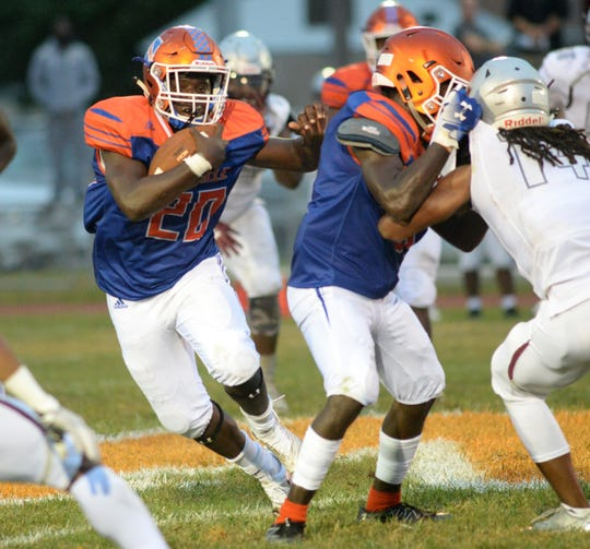 Millville's Aahznier Hayes carries the ball during the season opening football game against St. Peter's Prep at Millville Memorial High School, Friday, Aug. 31, 2018.