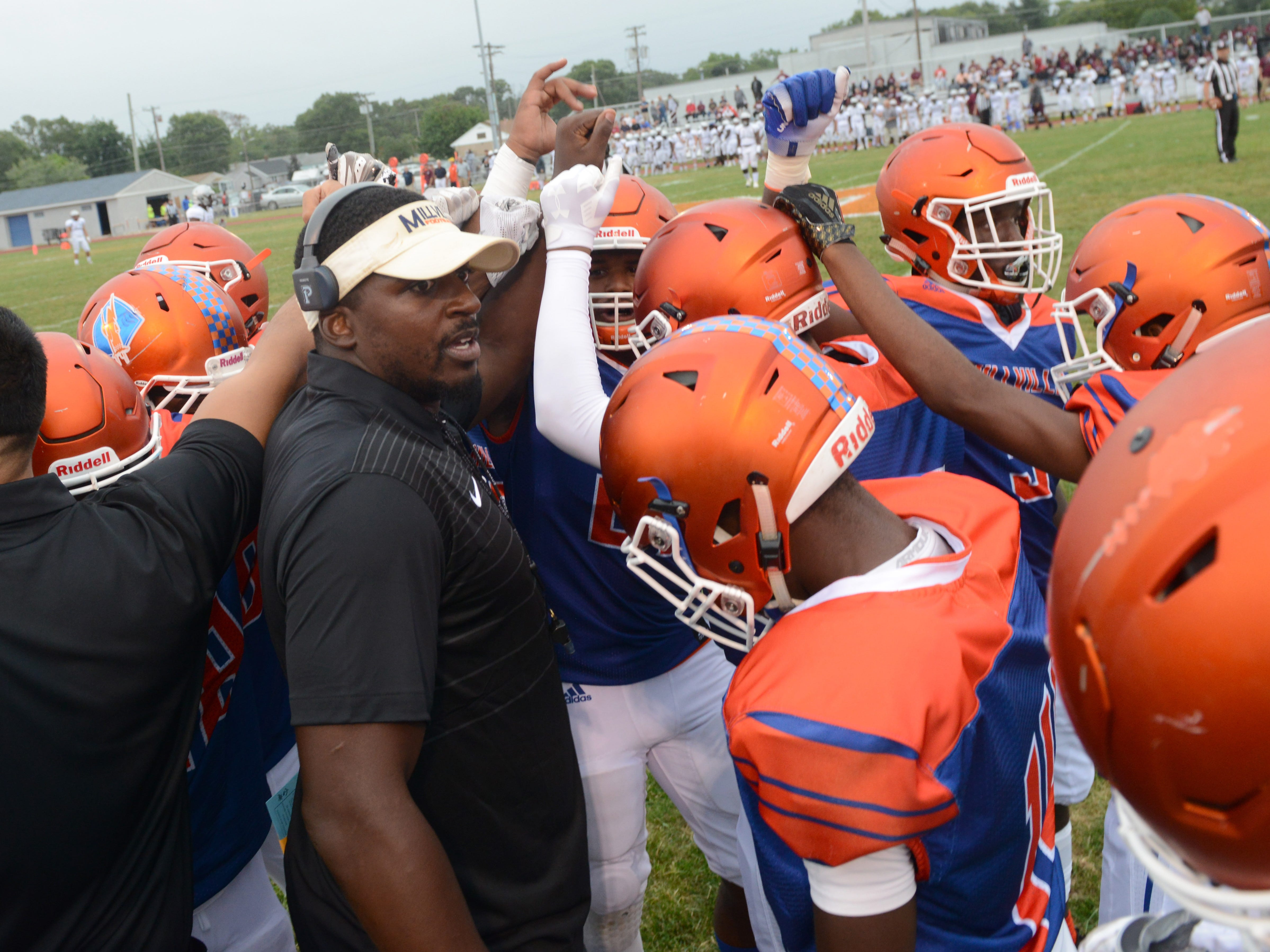 Millville head coach Dennis Thomas pumps up his team before the start of the season opening football game against St. Peter's Prep at Millville Memorial High School, Friday, Aug. 31, 2018.