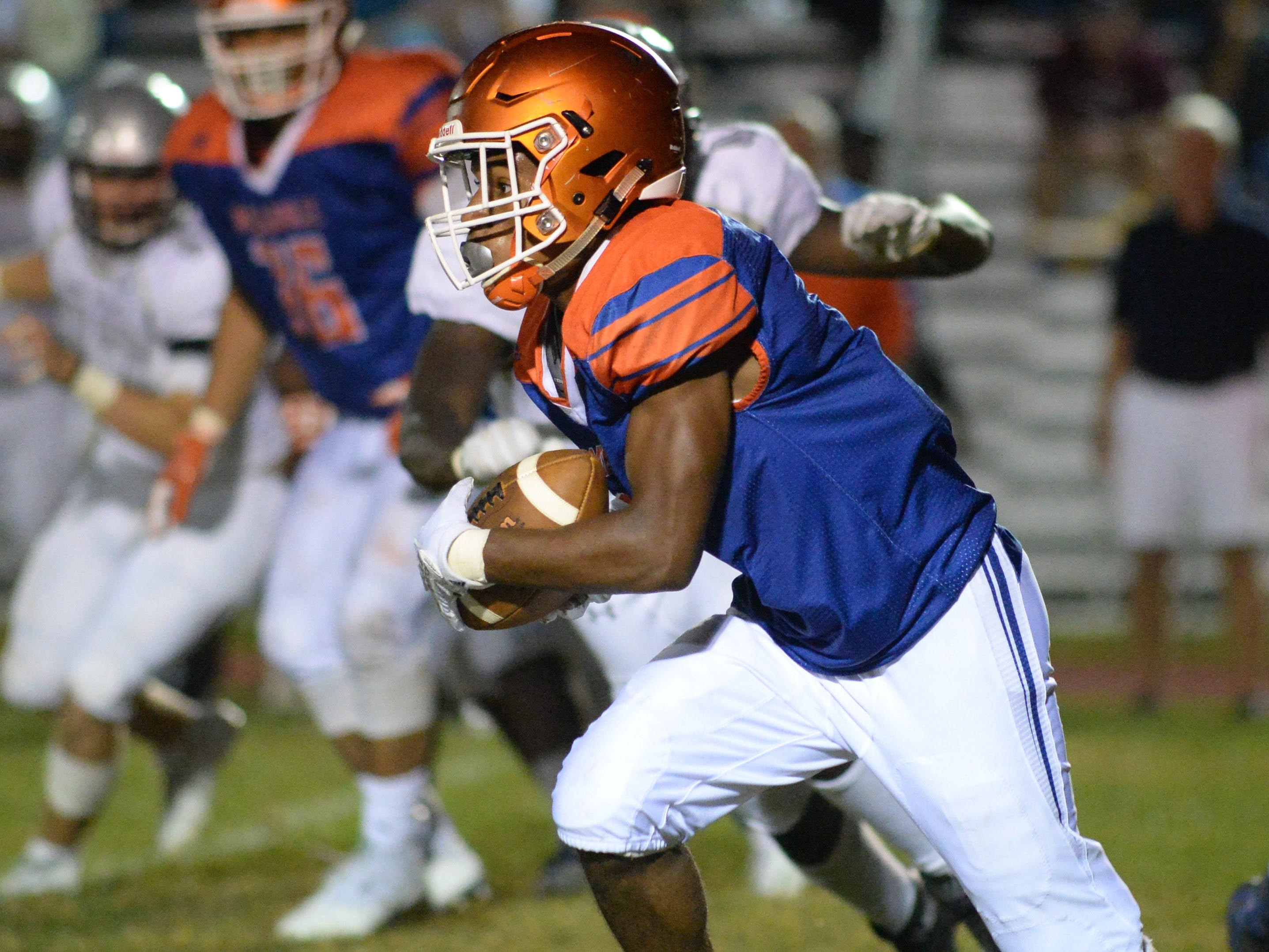Millville's Cartier Gray carries the ball against St. Peter's Prep during the season opening football game at Millville Memorial High School, Friday, Aug. 31, 2018.