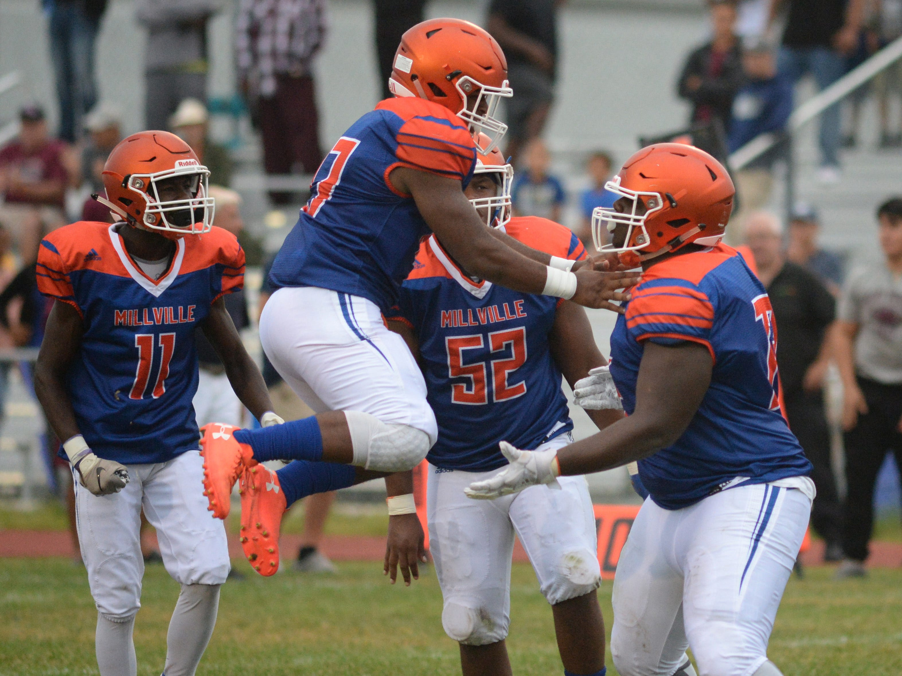 Millville's Sammy File, right, and Darius Watson react after making a defensive stop during the season opening football game against St. Peter's Prep at Millville Memorial High School, Friday, Aug. 31, 2018.