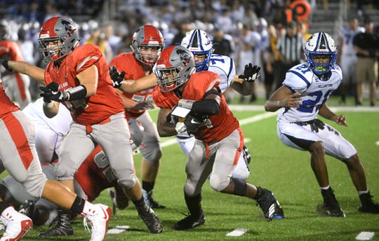Vineland RB, Nahzir Broome runs the ball for The Fighting Clan during the second quarter against Williamstown on Friday, August 31.