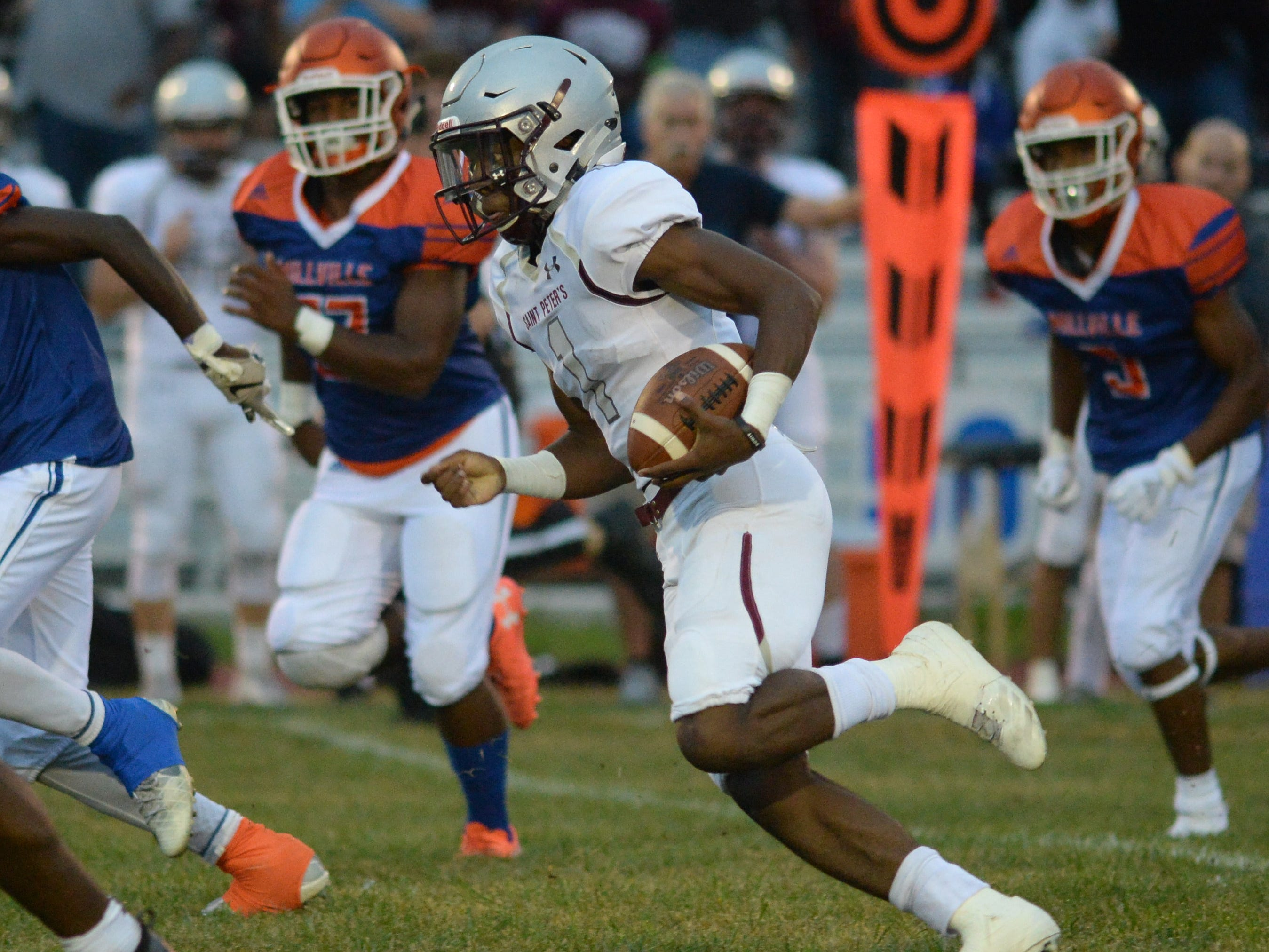 St. Peter's Prep's Ayir Asante carries the ball during the season opening football game against Millville at Millville Memorial High School, Friday, Aug. 31, 2018.