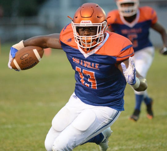 Millville's Shamore Collins carries the ball during the season opening football game against St. Peter's Prep at Millville Memorial High School, Friday, Aug. 31, 2018.