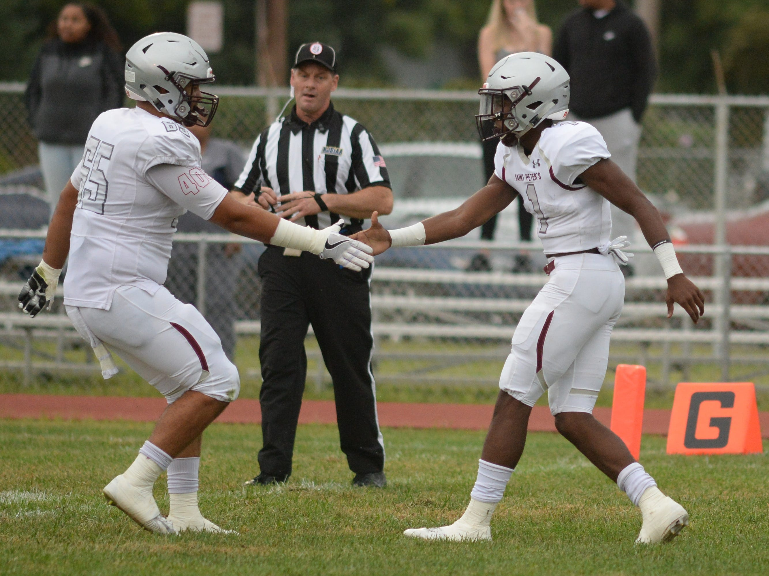 St. Peter's Prep's Ayir Asante celebrates with a teammate after catching a touchdown pass during the season opening football game against Millville at Millville Memorial High School, Friday, Aug. 31, 2018.