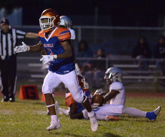 Millville's Cartier Gray reacts after breaking up a St. Peter's Prep pass during the season opening football game at Millville Memorial High School, Friday, Aug. 31, 2018.