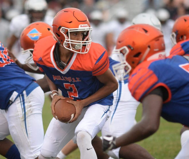 Millville's Eddie Jamison looks to hand the ball off during the season opening football game against St. Peter's Prep at Millville Memorial High School, Friday, Aug. 31, 2018.