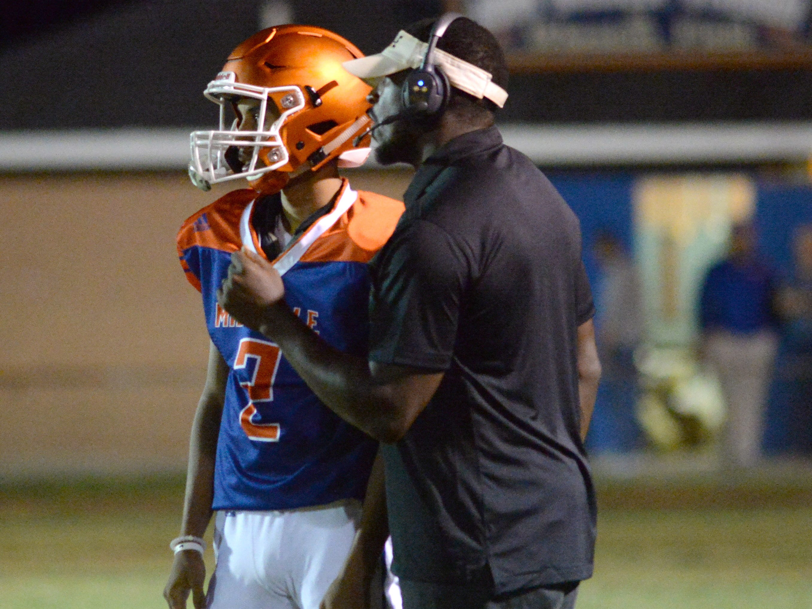 Millville's quarterback Eddie Jamison talks with coach Dennis Thomas during the season opening football game against St. Peter's Prep at Millville Memorial High School, Friday, Aug. 31, 2018.