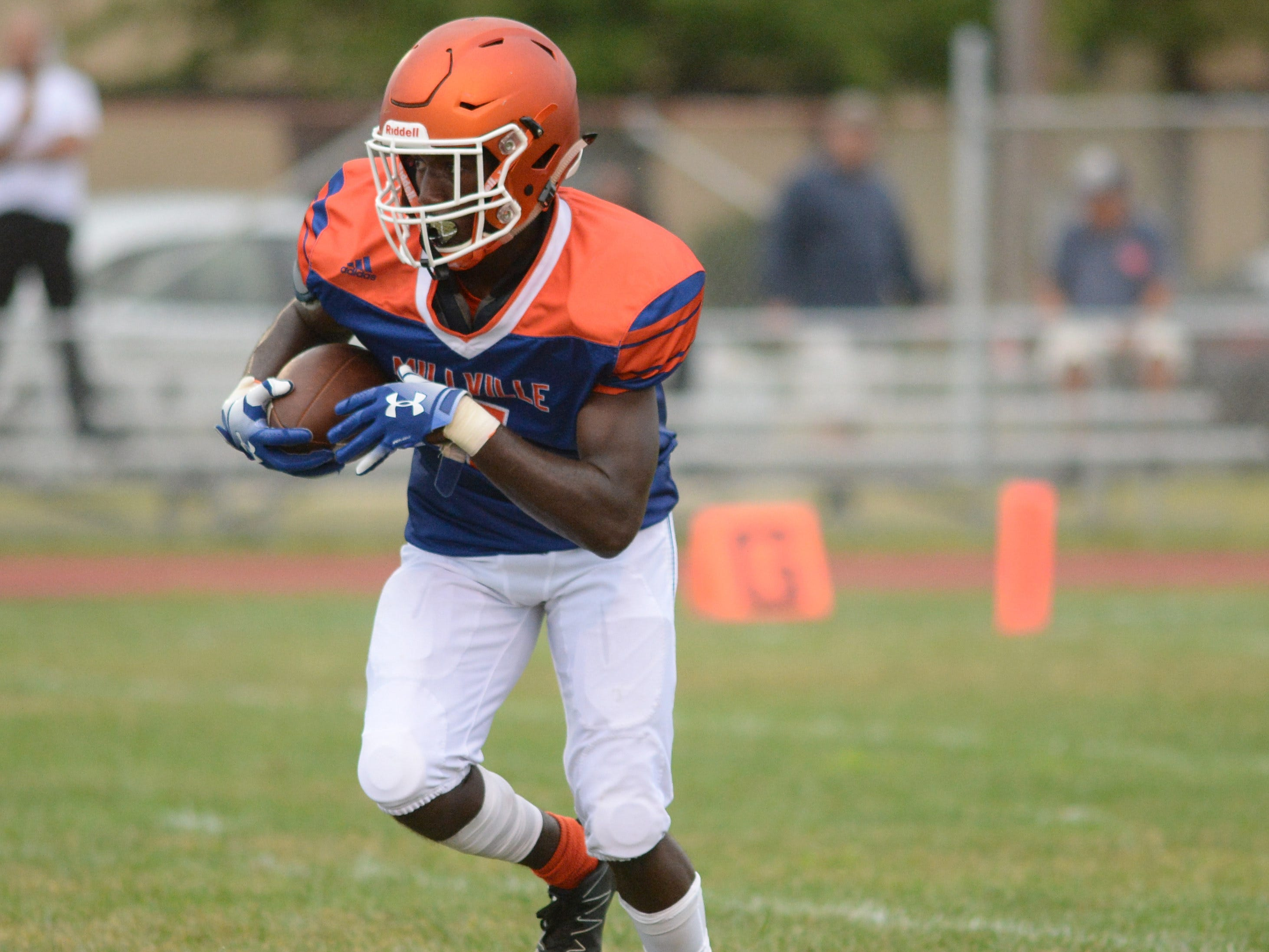 Millville's Kyle Yancy carries the ball during the season opening football game against St. Peter's Prep at Millville Memorial High School, Friday, Aug. 31, 2018.