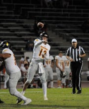 Tulare Union quarterback Nathan Lamb throws a pass against Redwood in a non-league game at Mineral King Bowl on August 31, 2018.