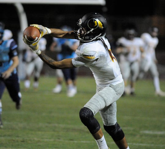Tulare Union's Darius Baker catches a pass against Redwood in a non-league game at Mineral King Bowl on August 31, 2018.