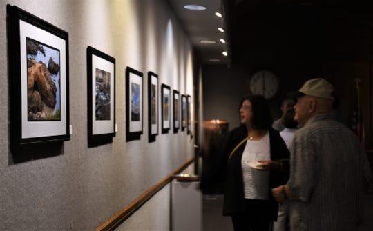 Gallery visitors observe Quitoriano's artwork