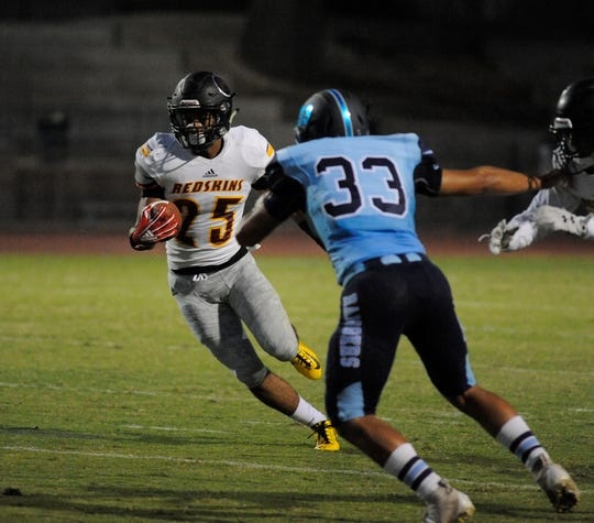 Tulare Union's David Dailey carries the football against Redwood in a non-league game at Mineral King Bowl on August 31, 2018.