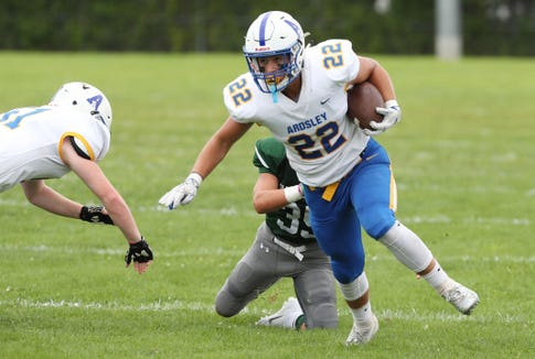 Ardsley's Brett Loccisano (22) breaks away from Pleasantville's Ray Raefski (35) on his way to a first half touchdown during football action at Parkway Field in Pleasantville Sept. 1, 2018.