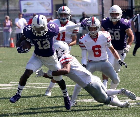 New Rochelle's Jessie Parson is tackle by Yonkers Brave's Nuryel Benitez during action in the New Rochelle vs. the Yonkers Brave football game at City Park in New Rochelle, Sept. 1, 2018