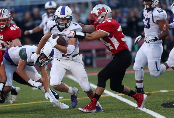 John Jay's Dean Ford (3) runs for 30 yards on the first play from scrimmage for John Jay against Somers  during opening night football action at Somers High School Aug. 31, 2018.