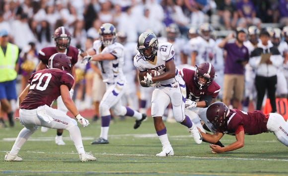 Clarkstown North's Dupree Darden (21) in action against Harrison at Harrison High School on Friday, August 31, 2018.