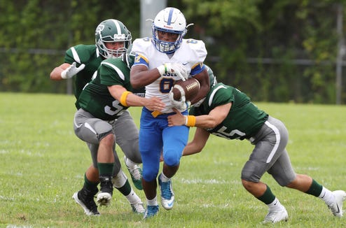Ardsley's Jalen Leonard-Osbourne (6) breaks away from a host of Pleasantville defenders on a first half run during football action at Parkway Field in Pleasantville Sept. 1, 2018.