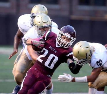 Ossining's John Turnquist rushes against the Yonkers Force during a varsity football game at Ossining High School Aug. 31, 2018. Ossining defeated the Yonkers Force 21-14.