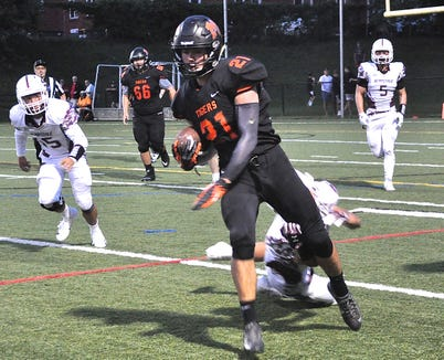 Mamaroneck running back Shane Smith avoids a Scarsdale defender during a football game at Mamaroneck High School on Friday, August 31st, 2018. Mamaroneck won 21-7.