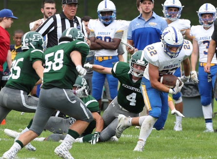 Ardsley's Brett Loccisano (22) breaks away from a host of Pleasantville defenders on a first half run during football action at Parkway Field in Pleasantville Sept. 1, 2018.