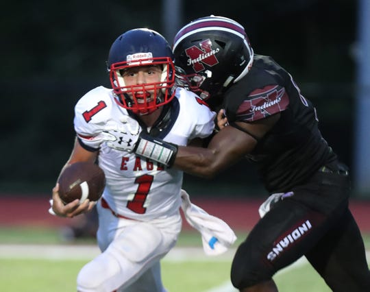 Nyack's Jachi Harper sacks Eastchester's Marc LoParrino during their game at Nyack Aug. 31, 2018. Nyack won 22-7 in the first game at their new field at the high school.