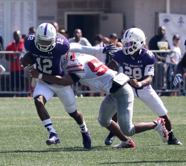 New Rochelle's Jessie Parson carries the ball during action in the New Rochelle vs. the Yonkers Brave football game at City Park in New Rochelle, Sept. 1, 2018