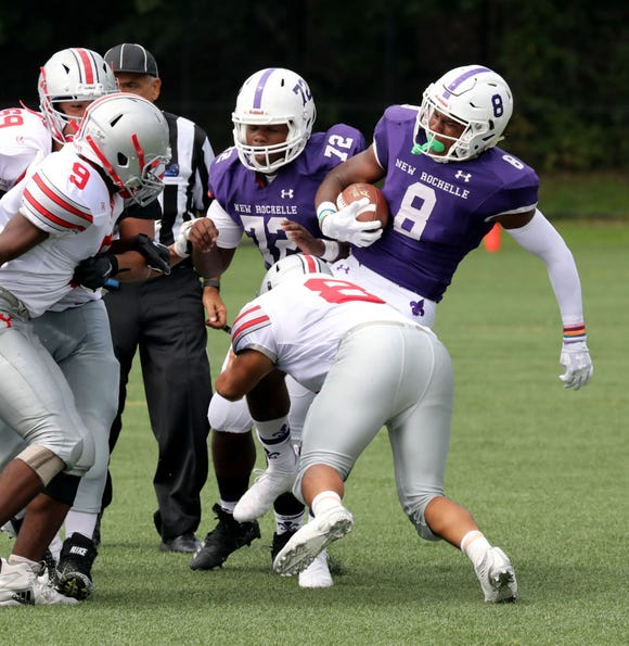 New Rochelle's Jordan Forrest spins during a tackle by Yonkers Brave's Manny Nunez, during action in the New Rochelle vs. the Yonkers Brave football game at City Park in New Rochelle, Sept. 1, 2018