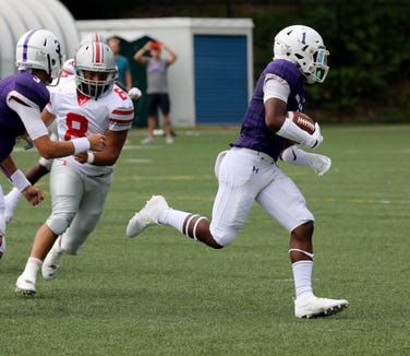 New Rochelle's Omari Walker runs toward the goal for a touchdown during action in the New Rochelle vs. the Yonkers Brave football game at City Park in New Rochelle, Sept. 1, 2018