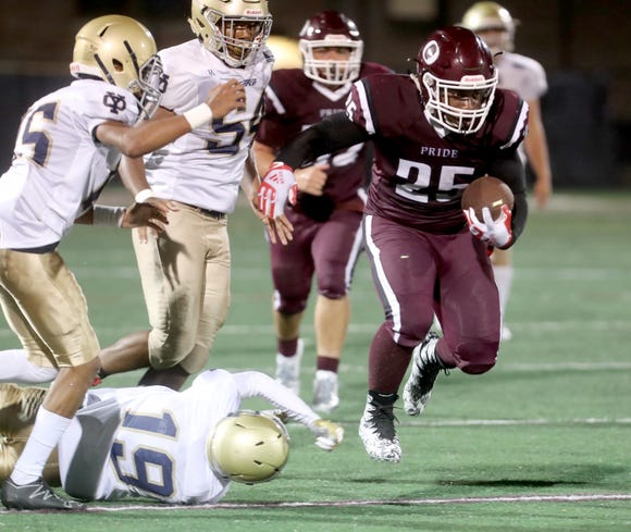 Ossining's Izaiah Steen evades Jacob Broquadio of the Yonkers Force during a varsity football game at Ossining High School Aug. 31, 2018. Ossining defeated the Yonkers Force 21-14.