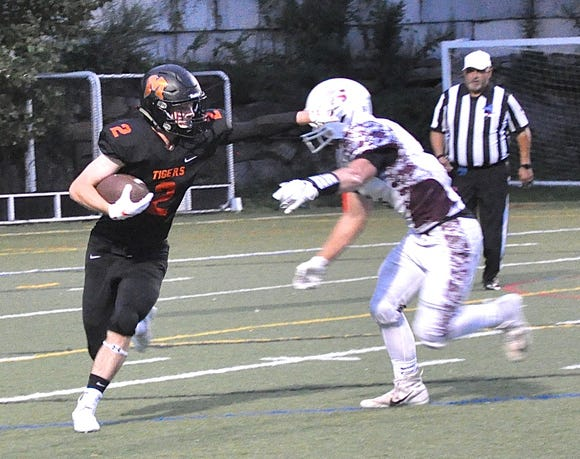 Action of a football game between Mamaroneck and Scarsdale at Mamaroneck High School on Friday, August 31st, 2018.
