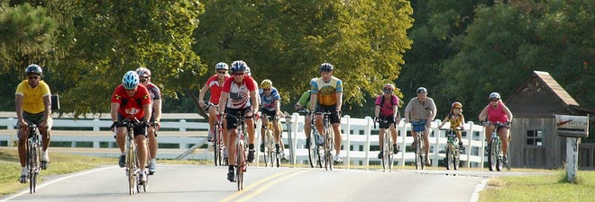 Bicyclists cruise the countryside west of Dover during a past Amish Bike Tour.