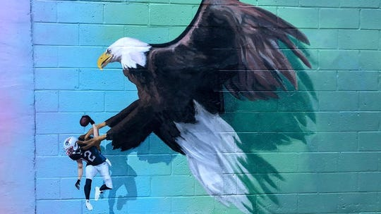 This painting inspired a new mural featuring the Lombardi Trophy instead of a hapless Tom Brady.