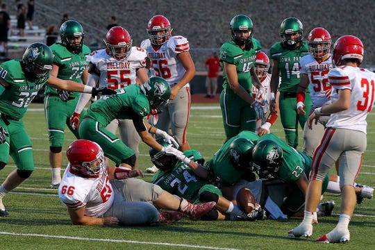 Iowa Park recovers the fumble Friday night in Iowa Park as the Hawks hosted the Eagles in Friday night action.