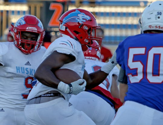 Hirschi's Daimarqua Foster runs upfield in the first game of the season against Graham Friday Aug. 31, 2018, at Graham's Newton Field.