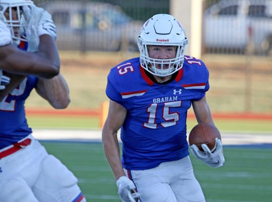 Graham's Daniel Gilbertson looks for a hole in the line of scrimmage against Hirschi Friday Aug. 31, 2018, at Graham's Newton Field.