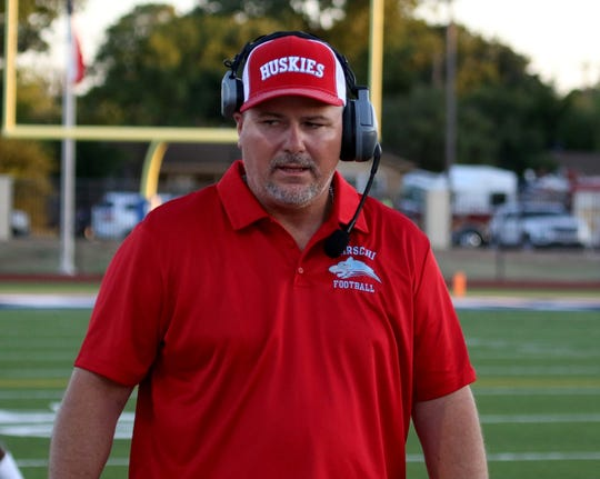 Hirschi head football coach Danny Youngs walks along the sideline against Graham Friday Aug. 31, 2018, at Graham's Newton Field.
