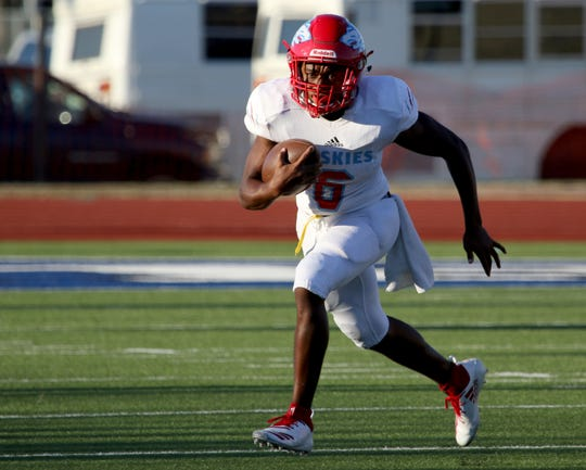 Hirschi's Nathan Downing runs for a gain after keeping the ball in the game against Graham Friday Aug. 31, 2018, at Graham's Newton Field.