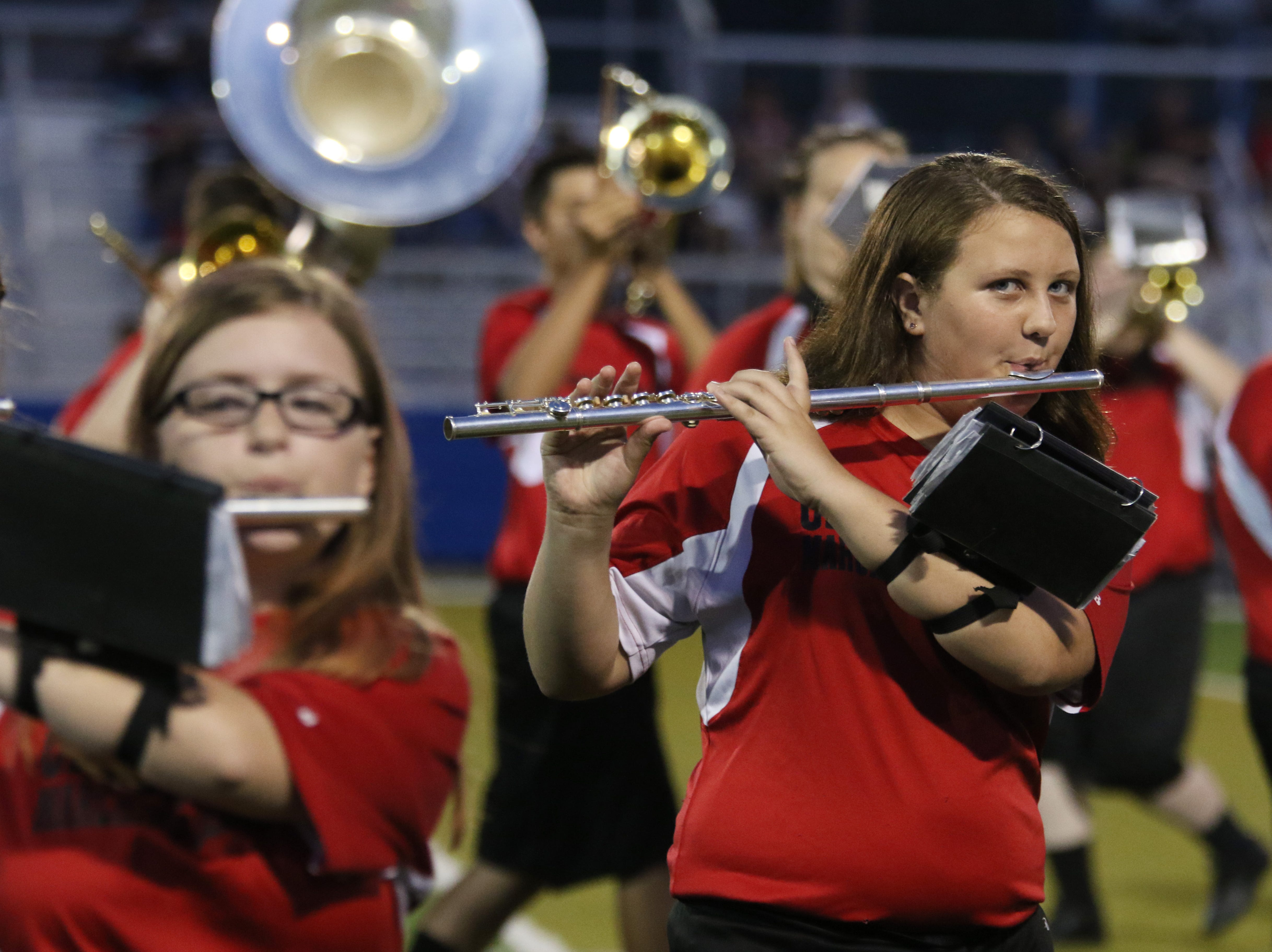The Crooksville High School marching band performs at half time at Philo.