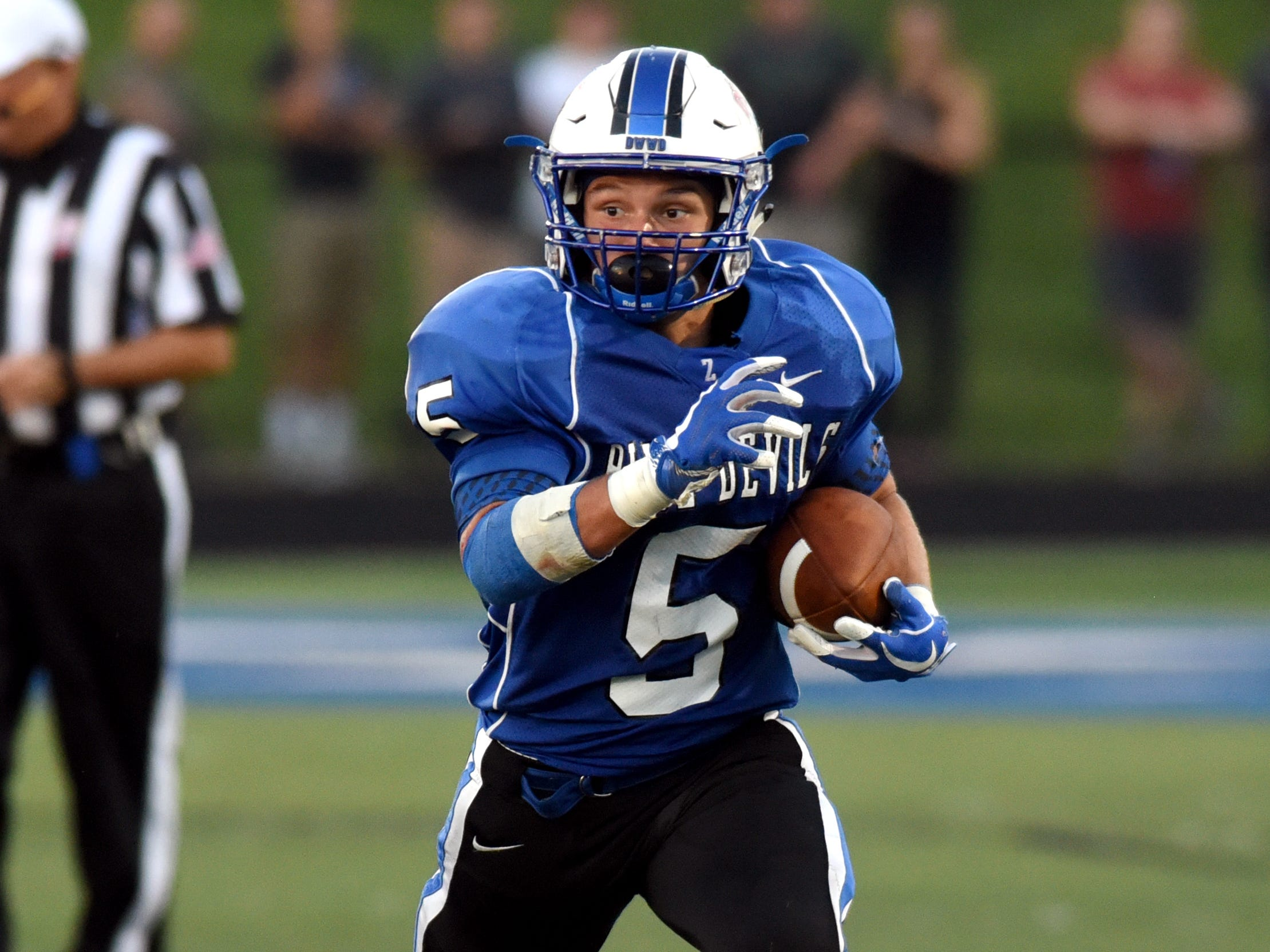 Zanesville's J.C. Curtis runs with the ball during the second quarter. Granville held on for a 17-14 win against the Blue Devils on Friday night at John D. Sulsberger Memorial Stadium.