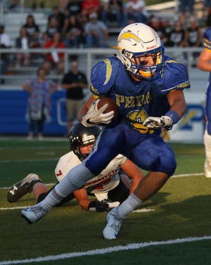 Philo's Casey Munyan carries the ball during a 47-0 win against Crooksville on Friday night at Sam Hatfield Stadium. Munyan ran for a game-high 141 yards.